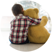 Picture of child hugging a stuffed bear
